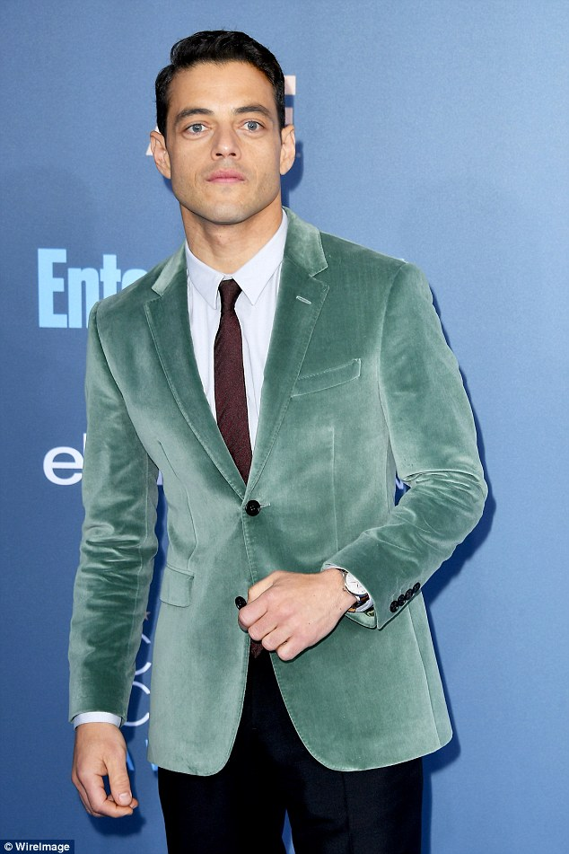 Green around the gills:Co-star Rami tried to embrace the fabric of the season, velvet, but his choice of light olive colour meant he missed the fashion mark