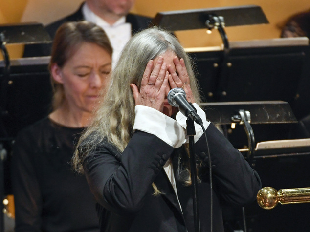 The veteran singer songwriter, Patti Smith (pictured) asked the orchestra to stop when she became struck by amnesia at the Stockholm ceremony on Saturday