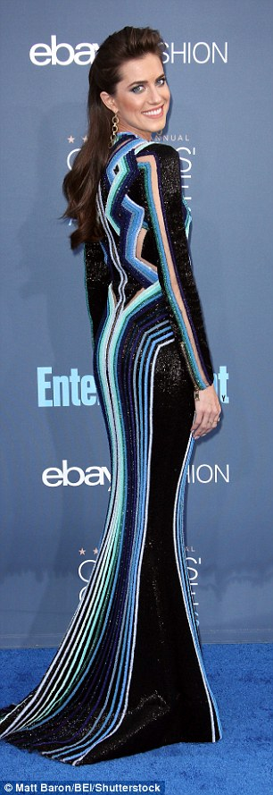 Not all that glitters is gold:The Girls' actress stepped out in a bold patterned dress created by heavy blue and green beading with nude panels