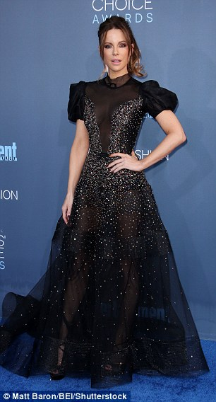 Opposites attract: Kate Beckinsale (L) and Lily Collins (R) dazzled in alternate black and white mesh ensembles as they led the British talent at the22nd Annual Critics' Choice Awards
