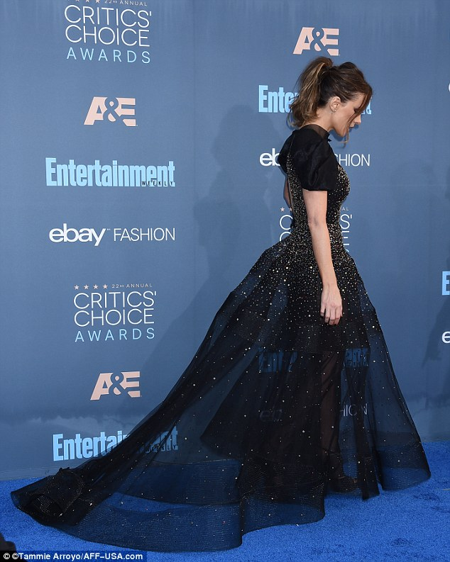 Shining: Adding a hint of glitz for her special night, the frock was then adorned with glittering diamanté gems all over