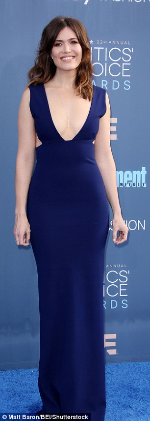 Flashing the flesh! Mandy Moore donned a plunging navy dress