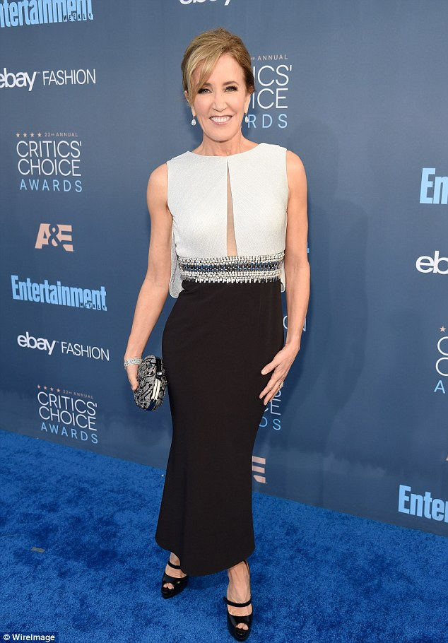 Glitzy! Felicity Huffman wore a monochrome ensemble with a wide sequin-encrusted belt