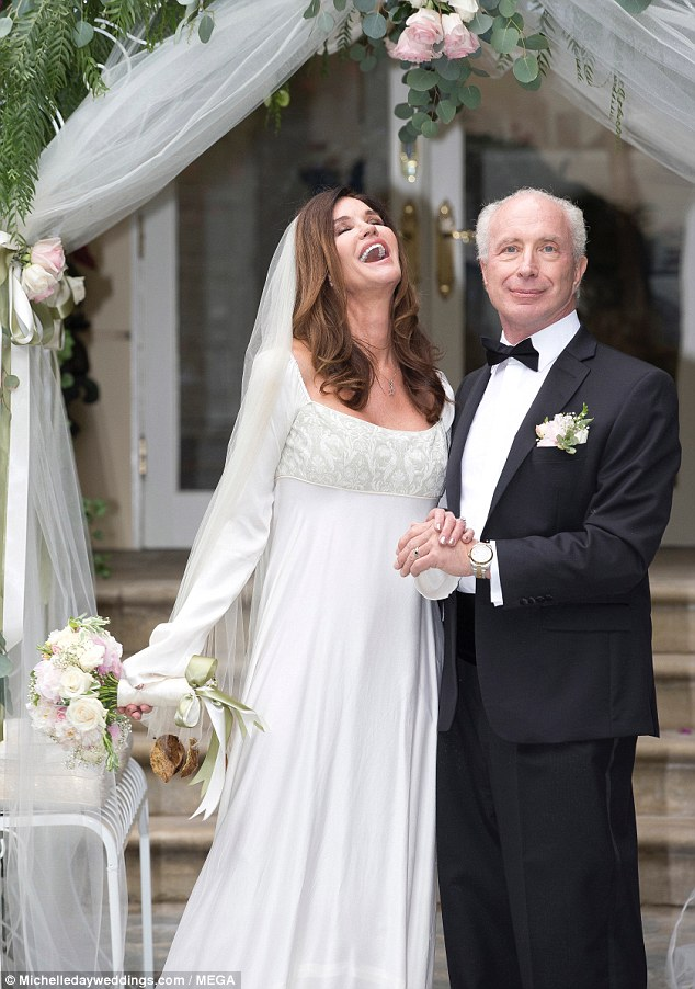 Fourth husband: Janice looked stunning as she threw back her head in joy, while they posed for formal photos