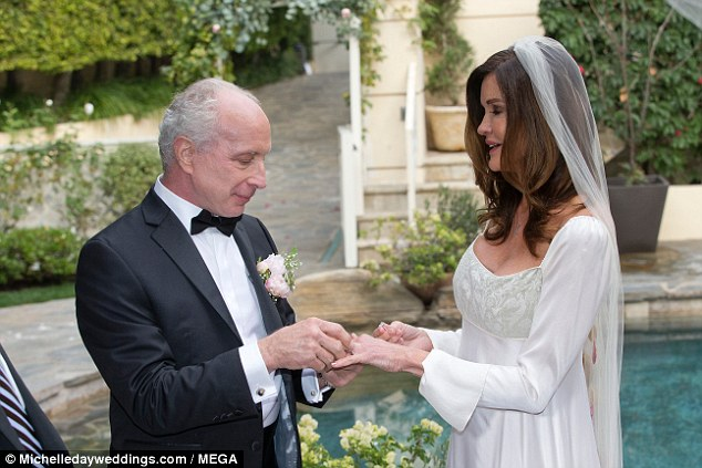 Bands: Janice - who was previously married to and divorced from Ron Levy, Simon Fields and Alan Gersten respectively - exchanged rings with her new husband in front of guests
