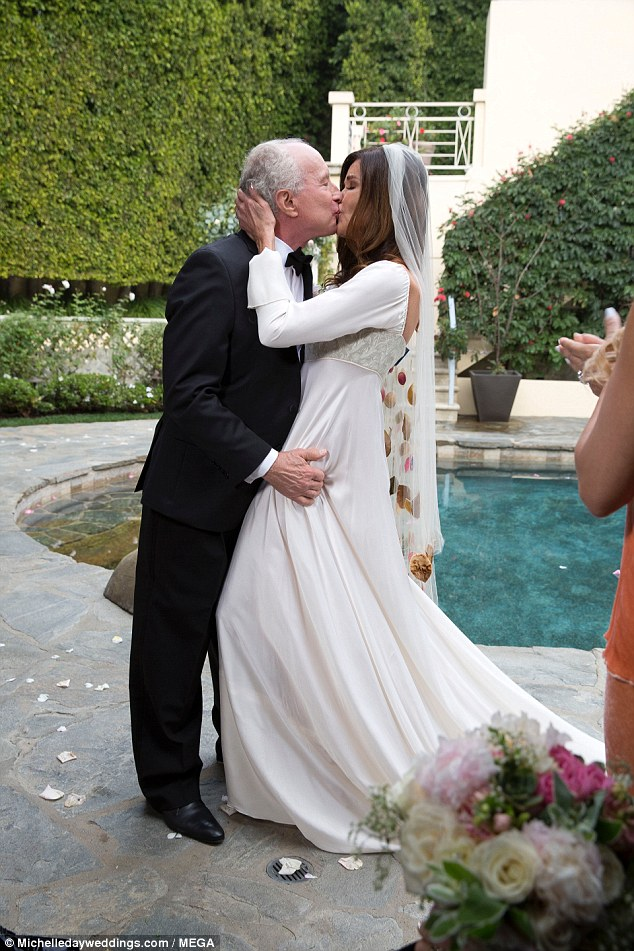 Puckered up: Guests applauded as they had their first kiss as man and wife
