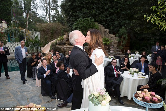 Fun times: The lavish ceremony was in front of around 100 friends and family members at the luxury Beverly Hills home of Dickinson's friend Suzan Hughes