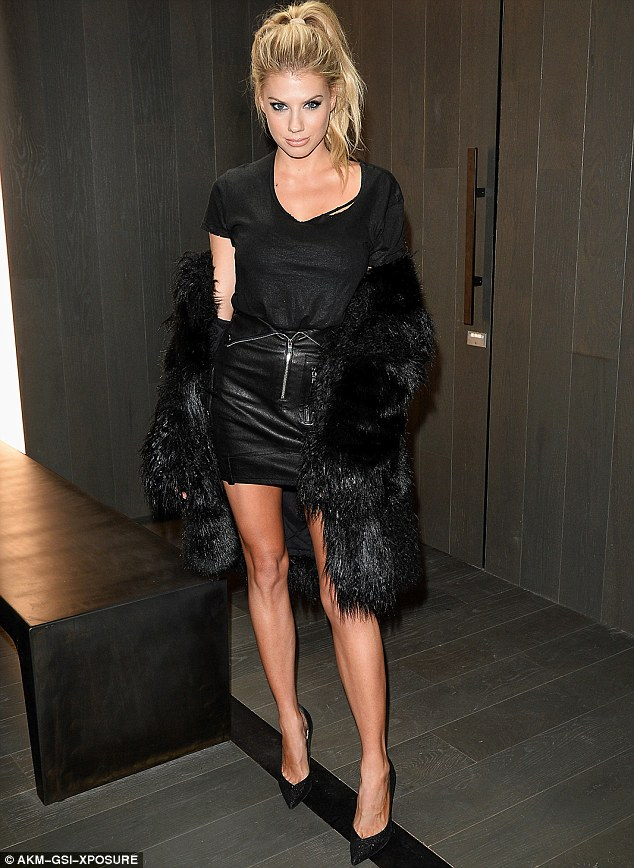 Imperial in leather: But Charlotte McKinney's cowskin and fur look seemed incongruous at the launch of a denin shop in Los Angeles on Sunday