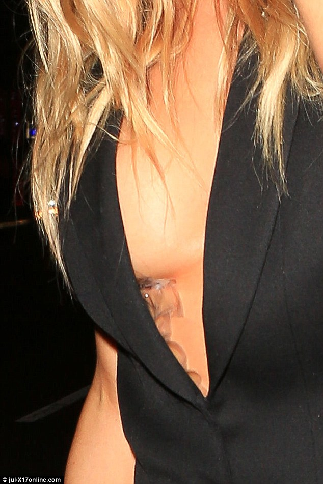 Tale of the tape: For her revealing top showed more than she bargained for, with her wardrobe tape on full display