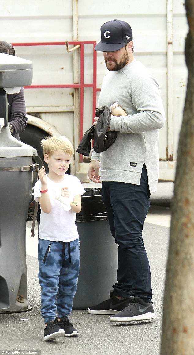 Father-son time: Comrie was snapped with Luca at the Los Angeles Farmer's Market over the weekend