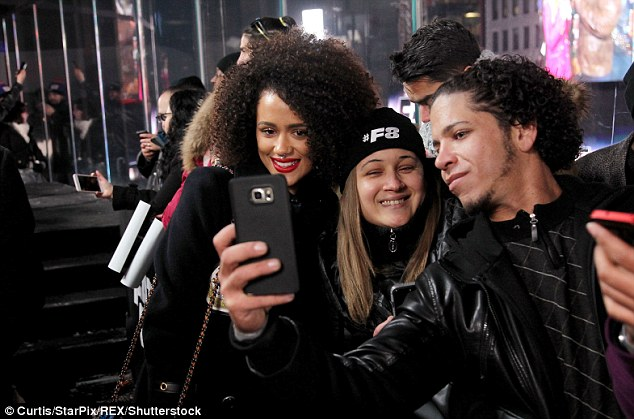 All smiles: The British actress smiled obligingly for a selfie