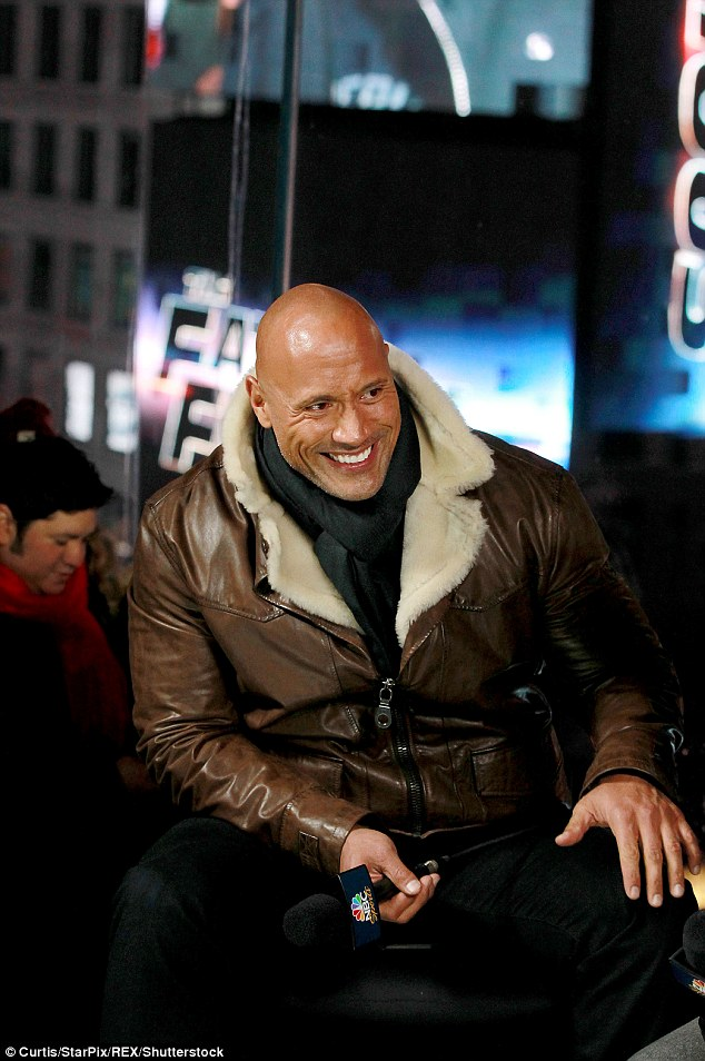 Having a whale of a time: The Rock wore a leather aviator jacket as he beamed away