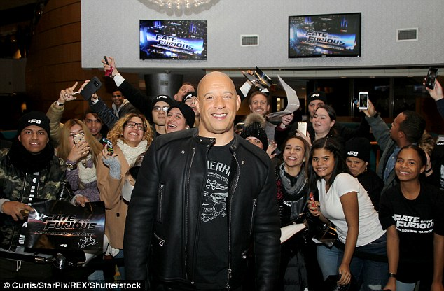 Taking centre-stage: Vin Diesel looked comfortable posing in front of hoards of eager fans