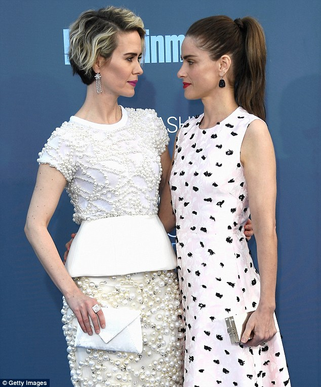 Focused: The starlet posed on the carpet with her best friend, Amanda, before heading inside