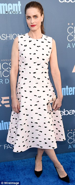 Stylish: The twosome struck Amanda cut a stylish figure in a patterned black and white dress; the frock had a cinched waist with a flared skirt