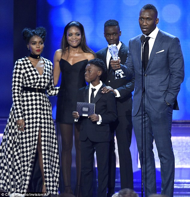 Success story: Naomie was on stage alongside co-stars Monae, Alex R. Hibbert, Ashton Sanders, and Mahershala Ali to accept the award for Best Acting Ensemble