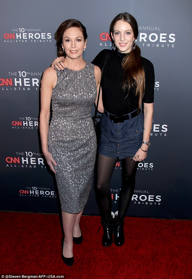 Mom and daughter time: Lane brought along her 22-year-old daughter Eleanor Lambert who rocked a denim mini skirt with a black top, black tights and black ankles