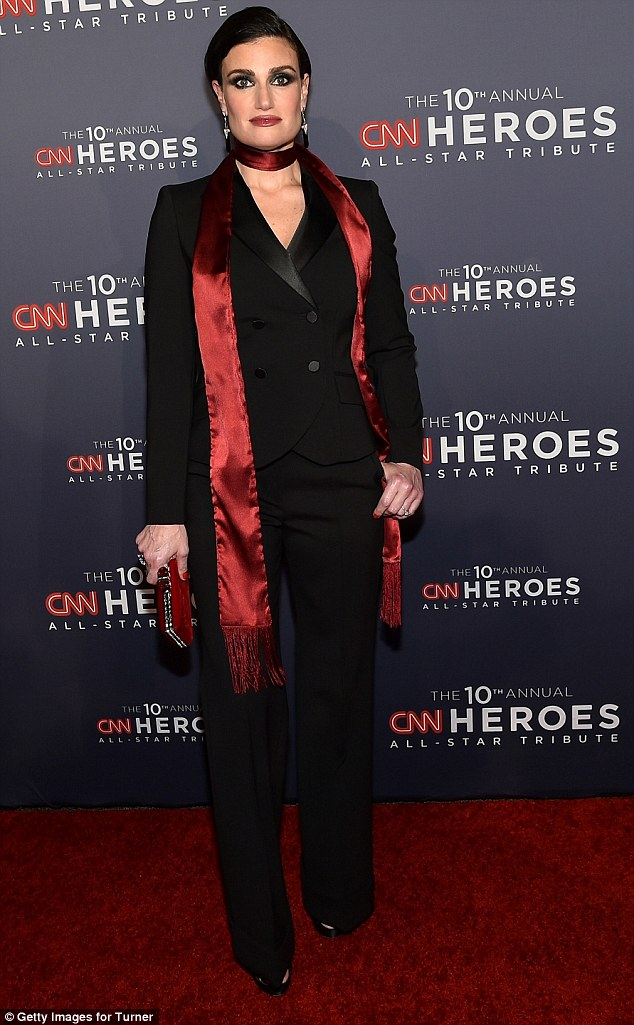Dapper: Idina Menzel, who performed during the evening, rocked a black pantsuit with a long red silky scarf tied around her neck