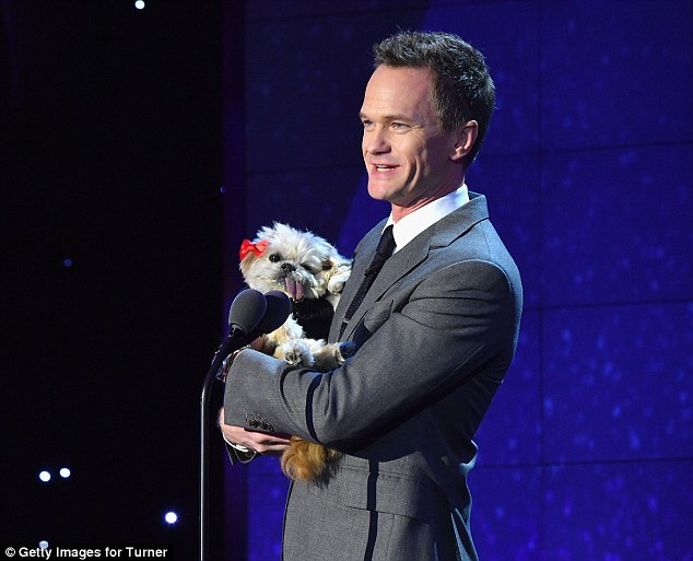 Doggie co-presenter: Neil Patrick Harris also appeared in the televised show arriving on stage carrying a furry canine friend
