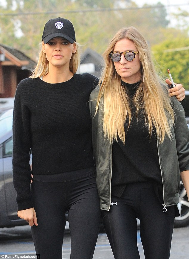 Sweat in style:Kelly showed off her trim and toned physique in a pair of Under Armour full length legging with a black jumper