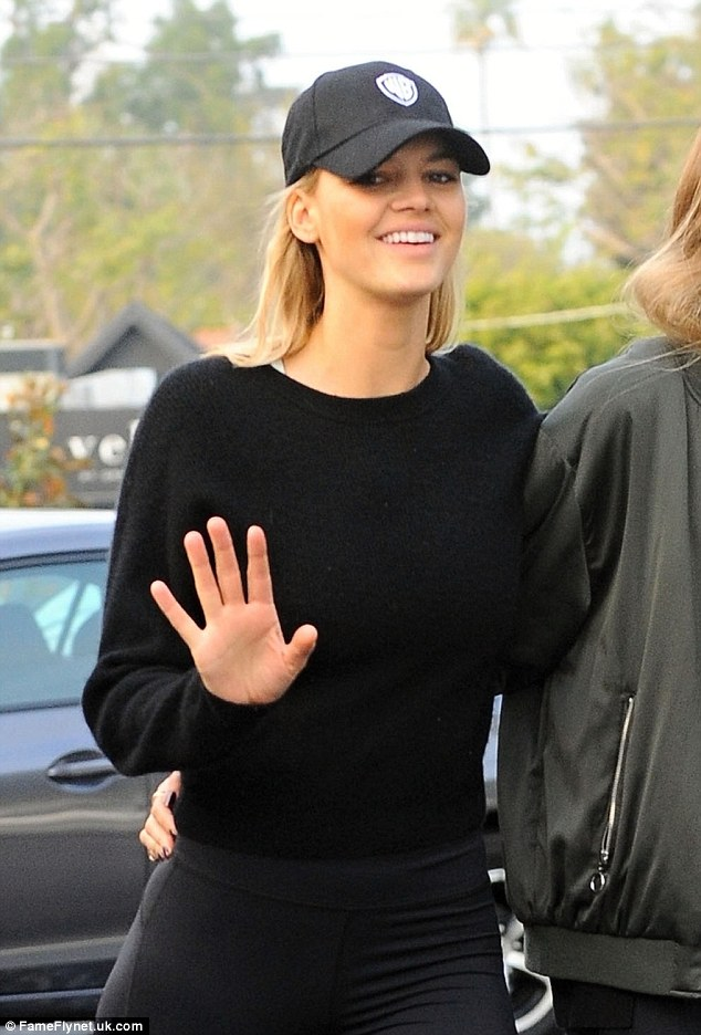 Treasured time:Kelly showed off her trim and toned physique in a pair of Under Armour full length legging with a black jumper
