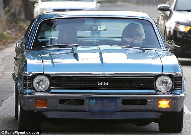 Shotgun! Gaga - born Stefani Germanotta - was joined on her scenic drive by a bespectacled, long-haired and goateed gentleman