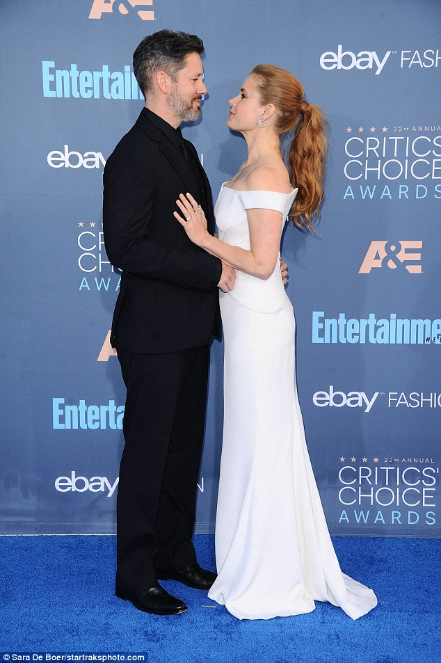Can't take his eyes off of her:Dressed to the nines in a gorgeous white Versace gown that clung to her curves, it's no wonder Darren couldn't keep his hands off of Amy