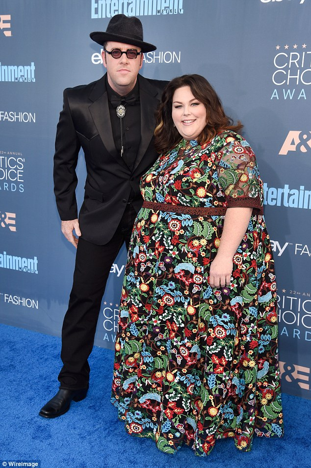 Had company: Chrissy, 36, was joined on the blue carpet by actor Chris Sullivan, who plays her boyfriend on the NBC drama