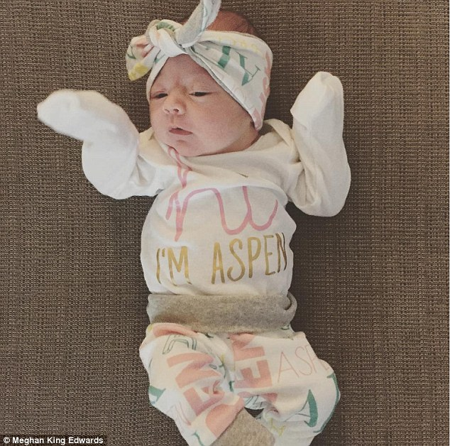 'hi I'M ASPEN': The newborn is her parents' first biological child together, though her father's had four children by two previous marriages