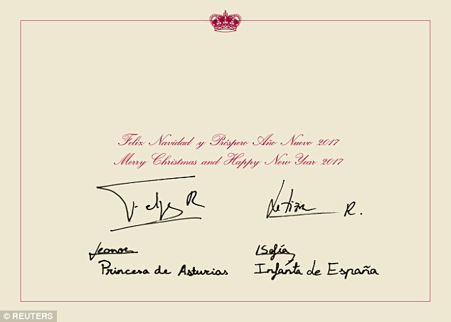The note inside the card, written in Spanish, reads ''Merry Christmas and a Happy New Year 2017,' with each of the royals adding their signatures