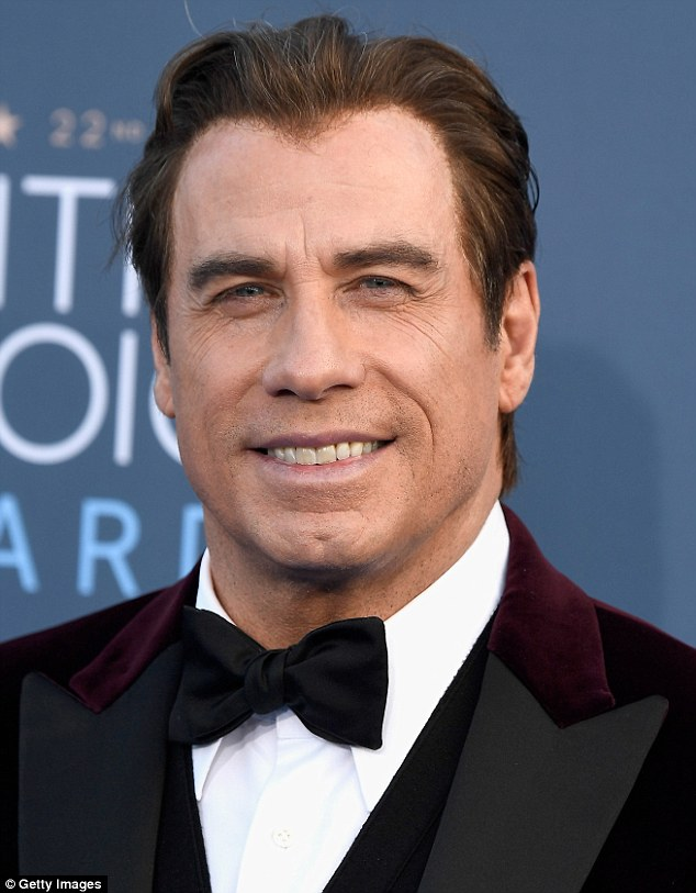 Hard to miss: John Travolta's welcome presence at the Barker's Hanger venhotos before making his way inside