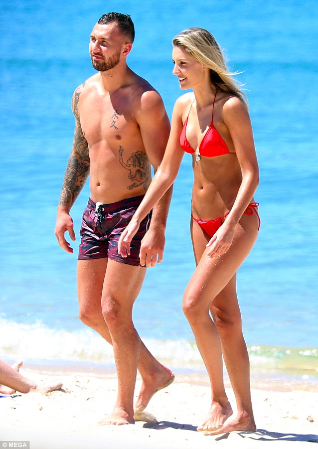 Hottie:Her hunky beau showed off his numerous arm and chest tattoos as he went shirtless