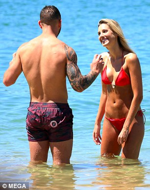 Hugging his tightly:Quade displayed his rock hard thighs as he wore a pair of red and black striped shorts, which wrapped tightly around his legs
