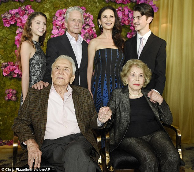 All together: On Friday, the trio joined Michael's wife Catherine Zeta Jones and stepmomAnne Buydens Douglas at his dad's 100th birthday party atthe Beverly Hills Hotel