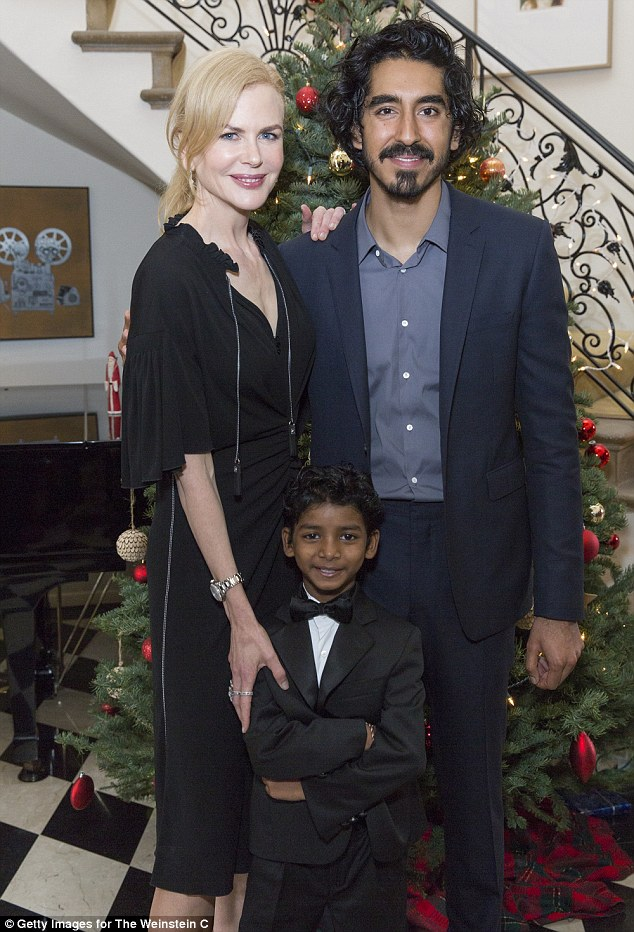 Government business: Nicole Kidman joined Lion co-stars Dev Patel (R) and Sunny Pawar (middle) and producers in paying a visit to the British Consulate in Los Angeles