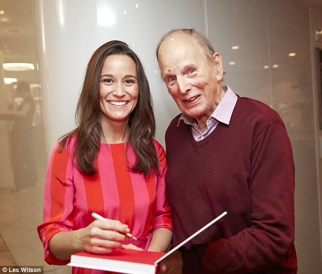 Pippa Middleton signs a copy of the book for Geoffrey Roughton, the founder and chairman of the Charing Cross British Heart Foundation support gorup