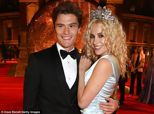 Smitten: The 25-year-old singer confessed that the moment Oliver (above) got down on one knee had left her 'speechless' - but that she does not want to rush planning the wedding