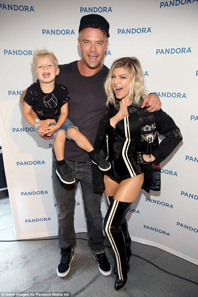 Family: She shares Axl with husband Josh Duhamel (pictured in August)