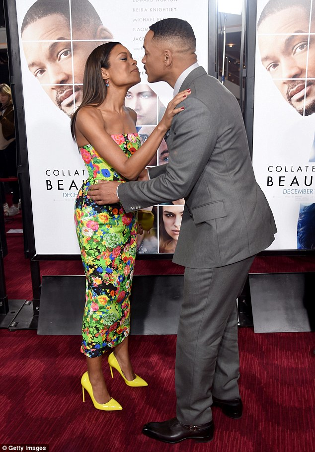 Sealed with a kiss: Naomie looked in high spirits as she mingled with her dapper co-star Will Smith on the red carpet