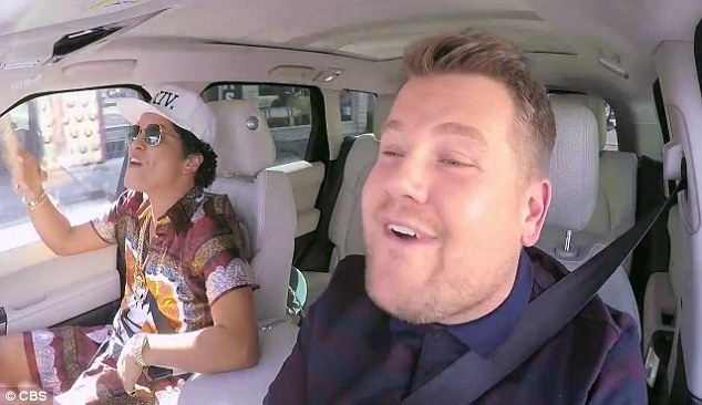 The four-time Grammy winner - who boasts 93M followers - wrote on social media: 'When an unstoppable force meets an immovable object @j_corden Thanks for the lift'