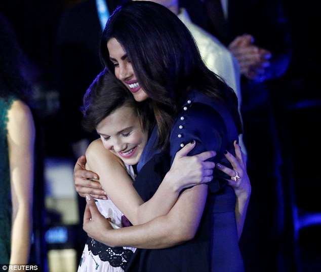 Smiling stars: Millie was also embraced at the star-studded event by Priyanka Chopra