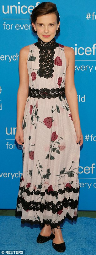 Hello petal: The 12-year-old wore a pale pink dress with black trim and a floral print
