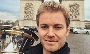 Nico Rosberg shows off his F1 world title in front of the Arc de Triomphe as he soaks up