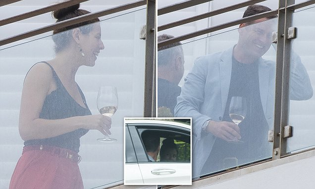 Karl Stefanovic and pal Sofia Levin enjoy drinks on a balcony together in Sydney