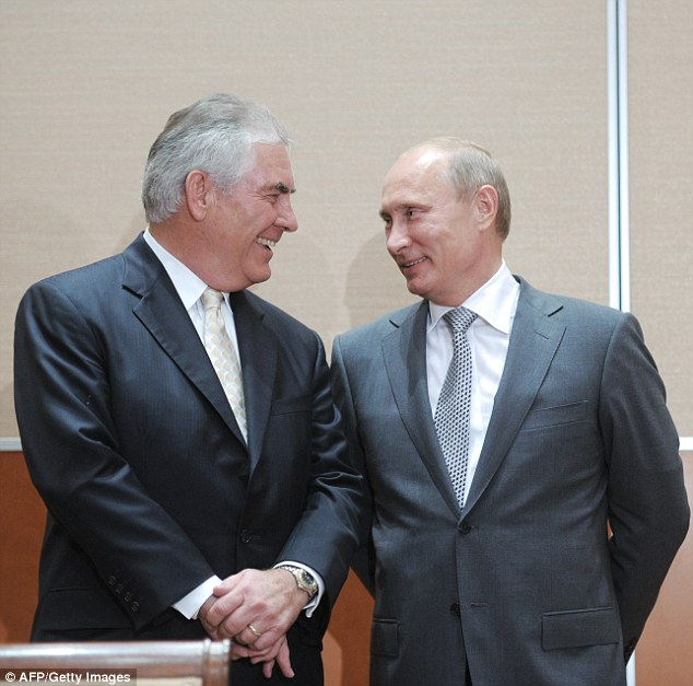 Russia's Prime Minister Vladimir Putin speaks with Rex Tillerson in Sochi in 2011