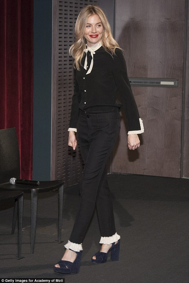 Well suited:For the star-studded screening, the star wore black straight leg trousers with a frilled white edge circling both her ankles