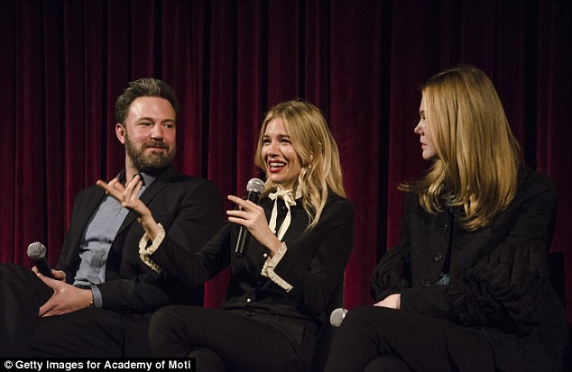Fashion flare:Sienna Miller stole the show as she walked in to join her co-stars Ben Affleck and Elle Fanning for a Q & A during a screening of film Live By Night in New York on Monday