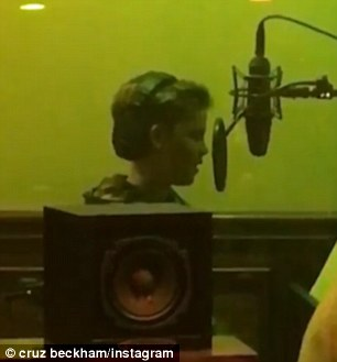 Good times: The youngster also uploaded a throwback video of him recording the song in the studio