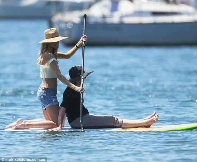 Summer ready:Jennifer Hawkins was back out on the water on Sunday as she happily paddleboard her mother Gail across the lake