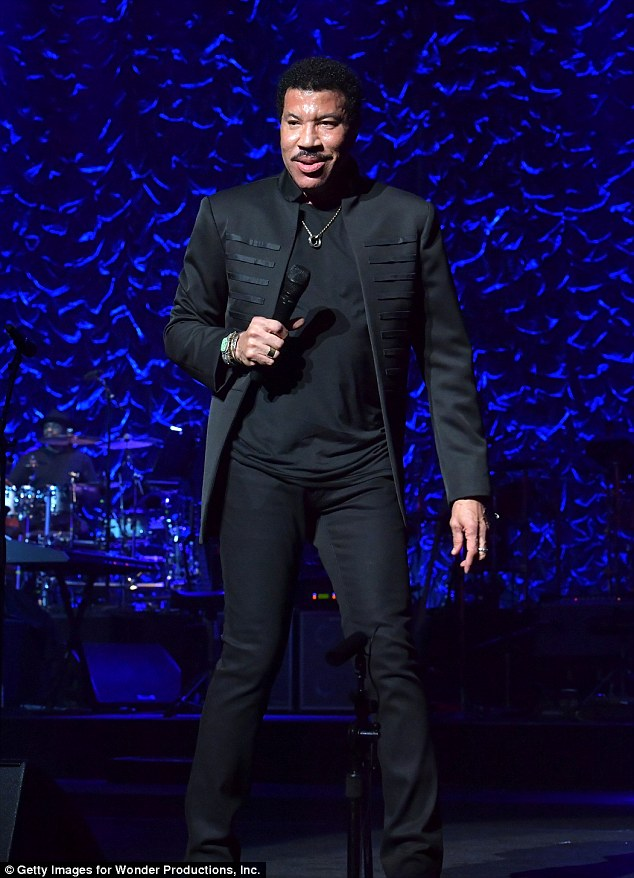 Still got it! The singer, 67, looked half his age as he wore a smart blazer